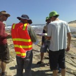 Volunteers reviewing estuary watch data at the Powlett River mouth