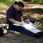 A Waterwatch volunteer records data from her tests
