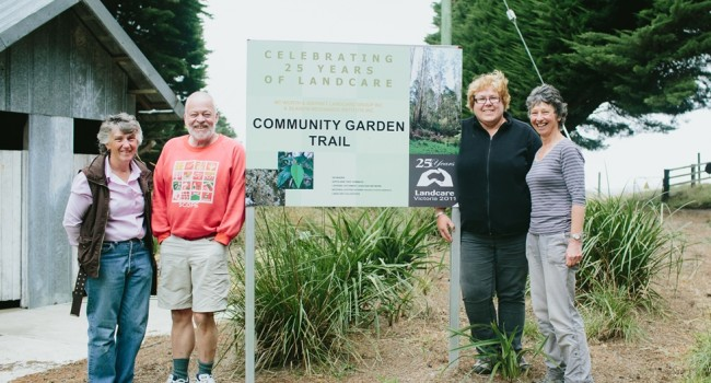 Mount Worth Landcare members at the Community Garden Trail sign