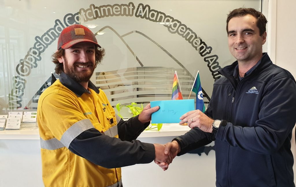 Winner of the WGCMA Love our Waterways photo competition Will Lawrey and WGCMA Environmental Water Officer Dr Adrian Clements.