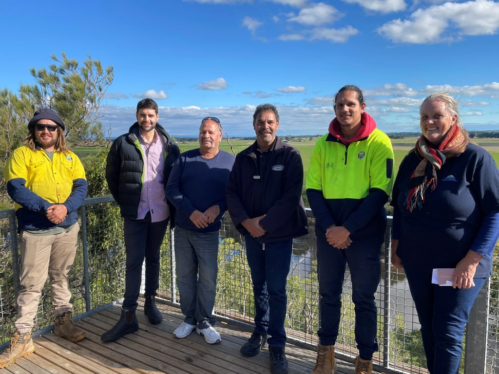 The team from GLaWAC with employees Mandy and Jackson standing at the lookout at Knob Reserve